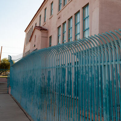 A Security Fence in Front of a Building.
