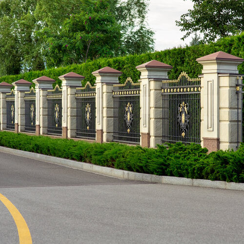 Iron fence with stone columns.